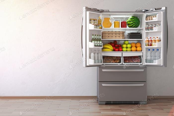 Open fridge  refrigerator full of food in the empty kitchen inte