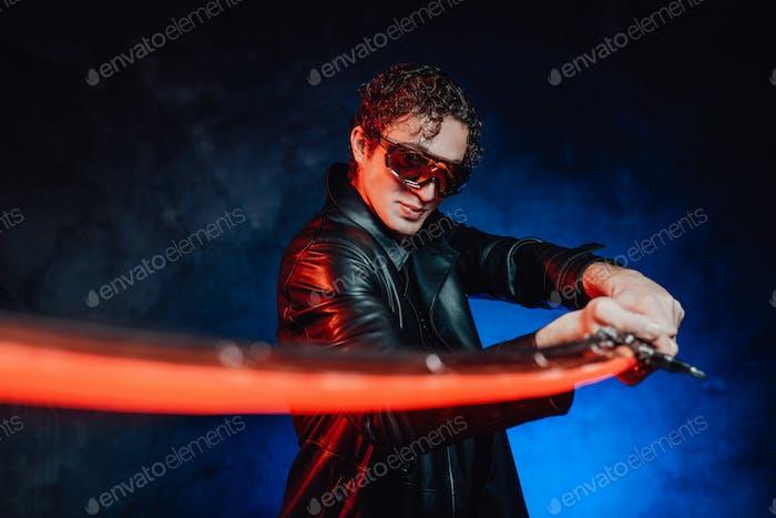 Futuristic martial man with sunglasses and sword