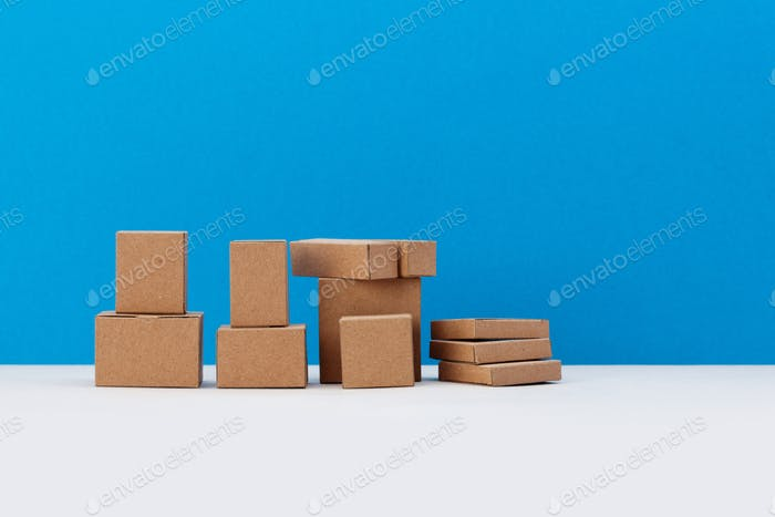 Blank carton containers, packaging concept. Cardboard craft paper boxes different size.