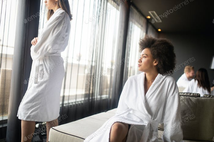 Portrait of a beautiful young healthy black woman relaxing in a robe