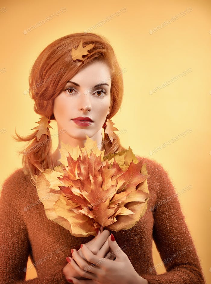 Beauty portrait redhead woman, autumn leafs,people