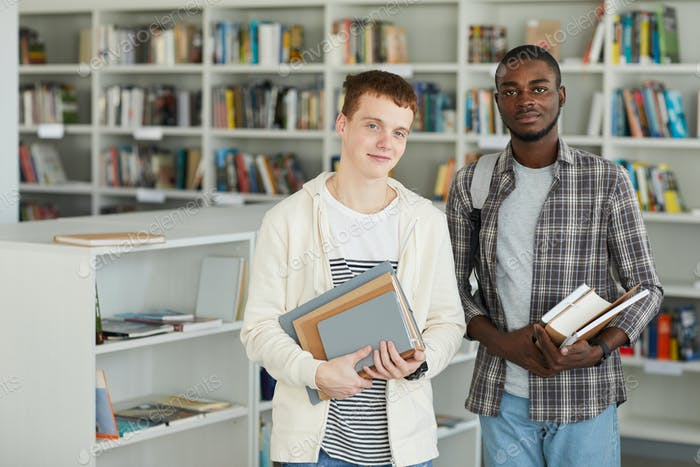 Two Boys Standing in College Library