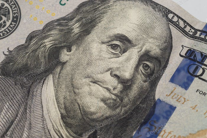 Dollars closeup. Benjamin Franklin's portrait on new one hundred dollar banknote.