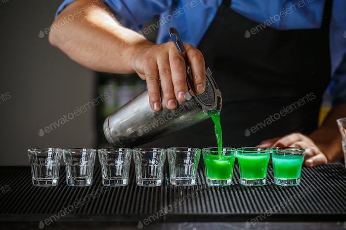 Barman pouring hard spirit