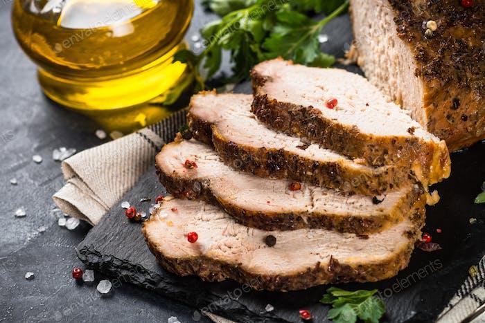 Baked pork meat ham on black