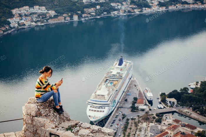 woman using smartphone app and travel