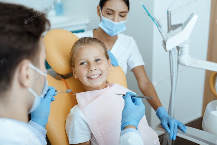 Modern dental examination and oral cavity treatment in children