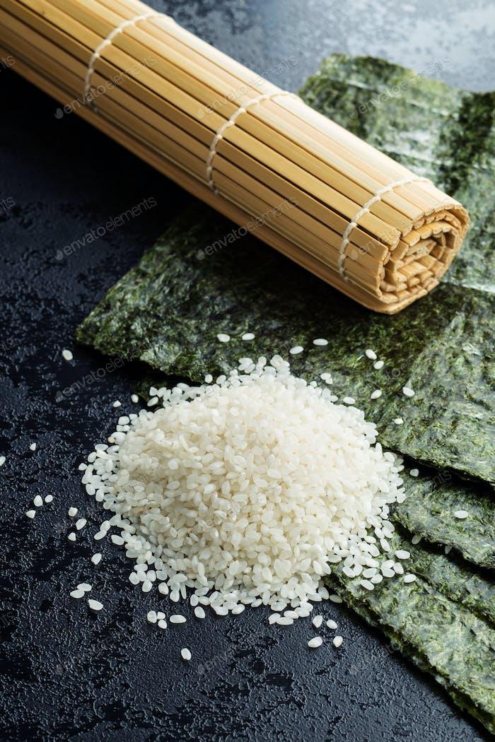 Green nori sheet , rice and bamboo mat.