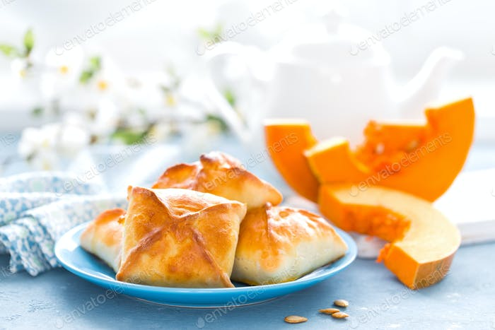 Delicious homemade baking. Patties with fresh pumpkin on white background, closeup