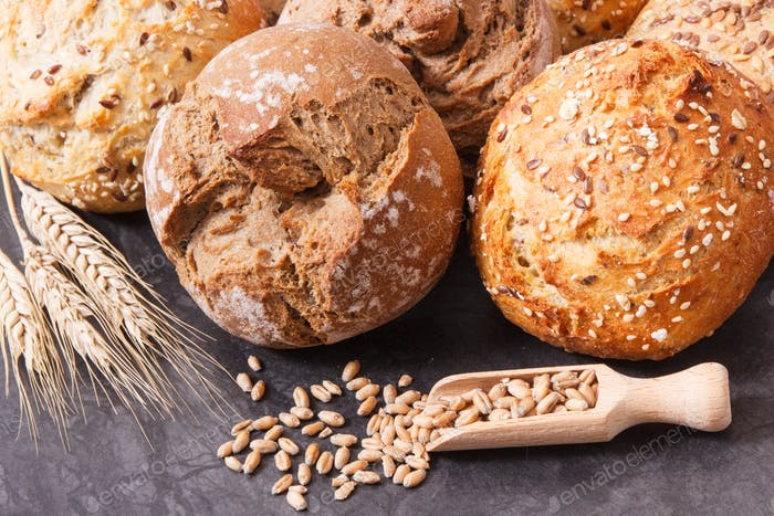 Fresh baked homemade wholegrain rolls or bread with seeds
