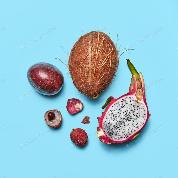 Set of exotic fruit pitahaya, lychee, passion fruit, coconut on a blue background with space for