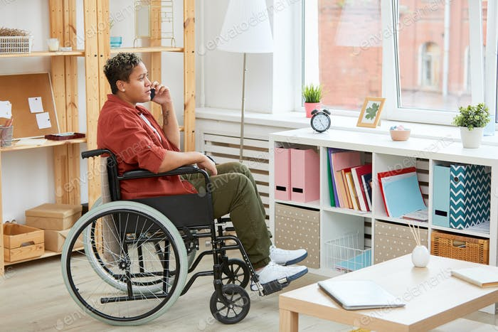 Disabled woman talking on the phone