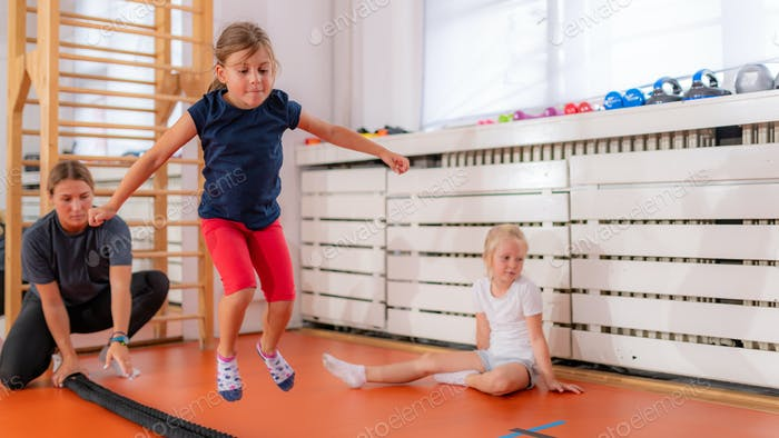 Jumping over rope in a physical activity class