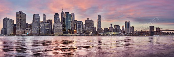 Purple sunset over Manhattan skyline, New York, USA.