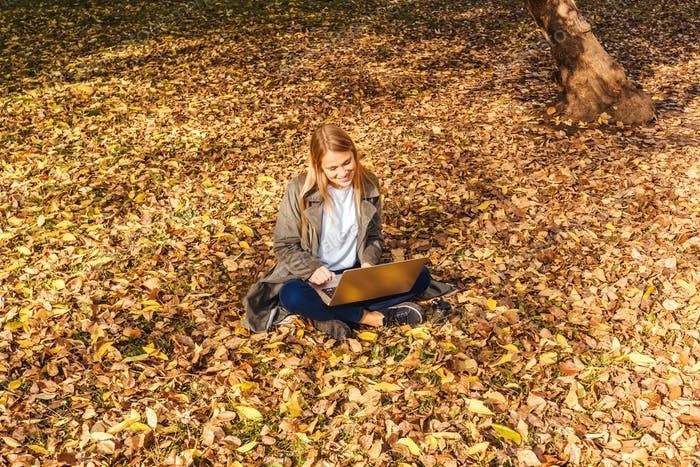 Young businesswoman working on nature with laptop.