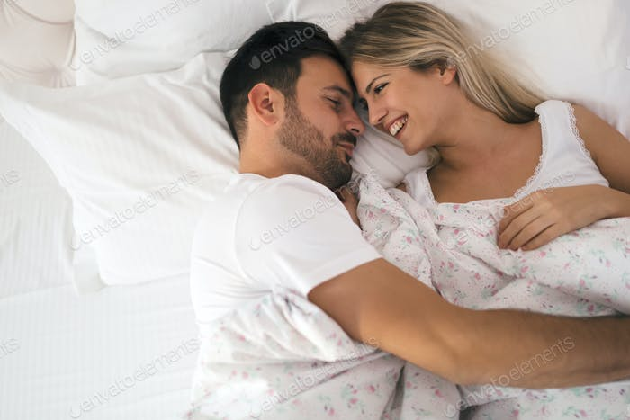 Romantic couple in bed in nightwear