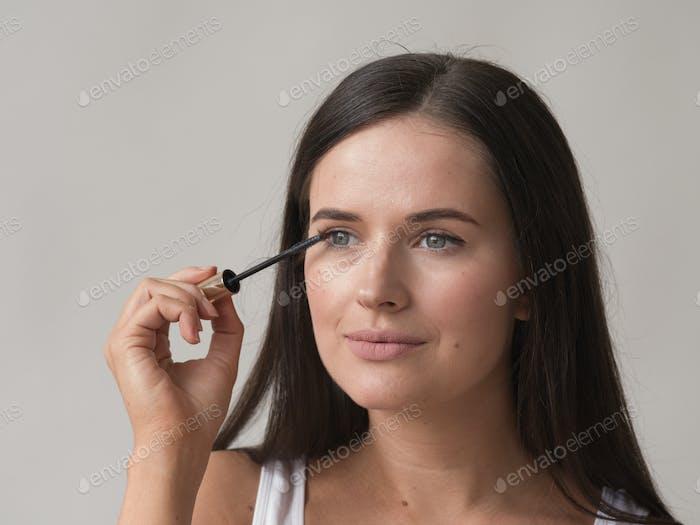 Woman makeup mascara eyes healthy skin natural fashion makeup