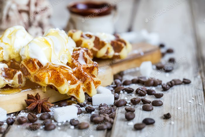 Waffers with ice cream and honey background