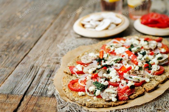buckwheat Chia seed pizza crust with mushrooms, tomato, Basil an