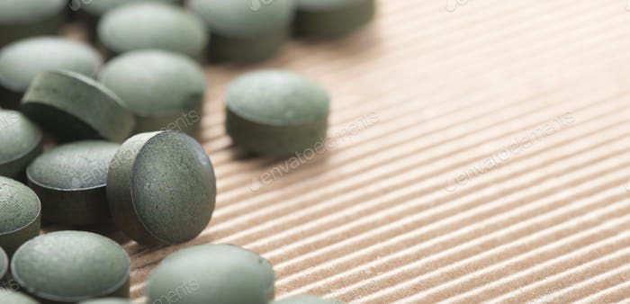 Pure Organic Spirulina Tablets with Copy Space