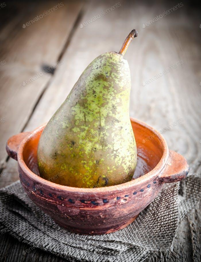 Green pear in rustic decor