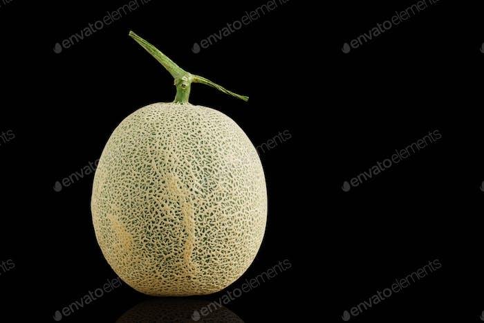 Melon on black background