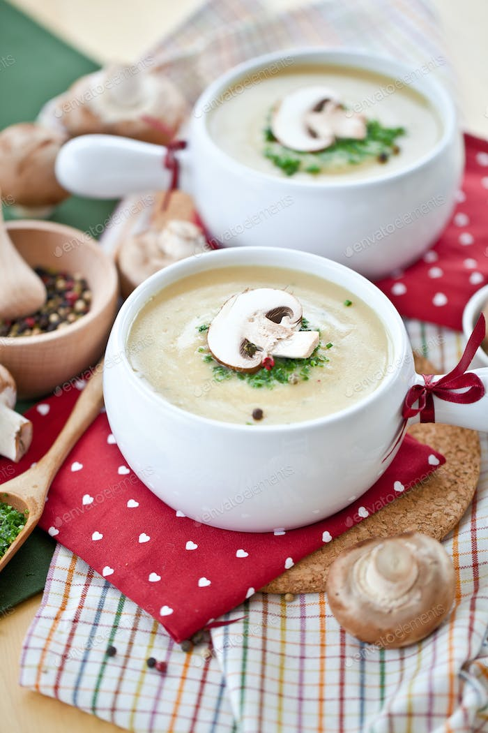 Two bowls of creamy mushroom soup