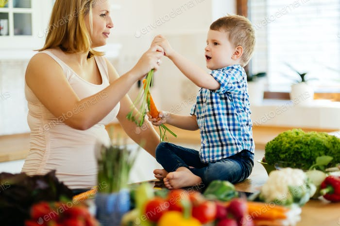 Mother and child preparing lunch