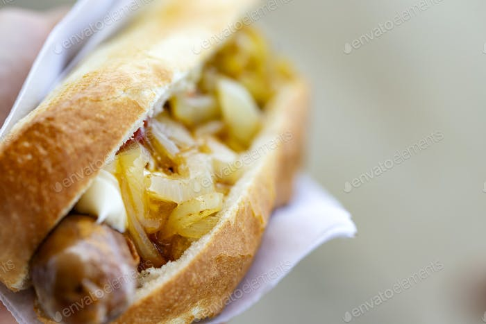 hot dog with grilled sausage and fried onion