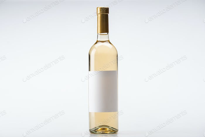 bottle of white wine with blank label on white background