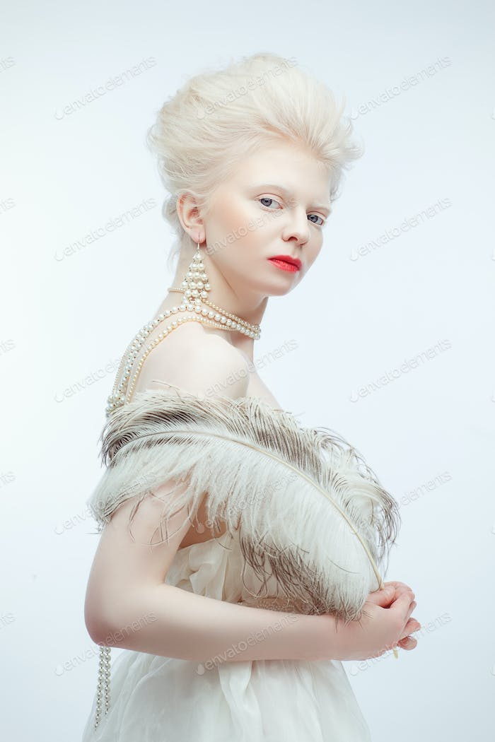 beautiful albino girl with red lips on white background