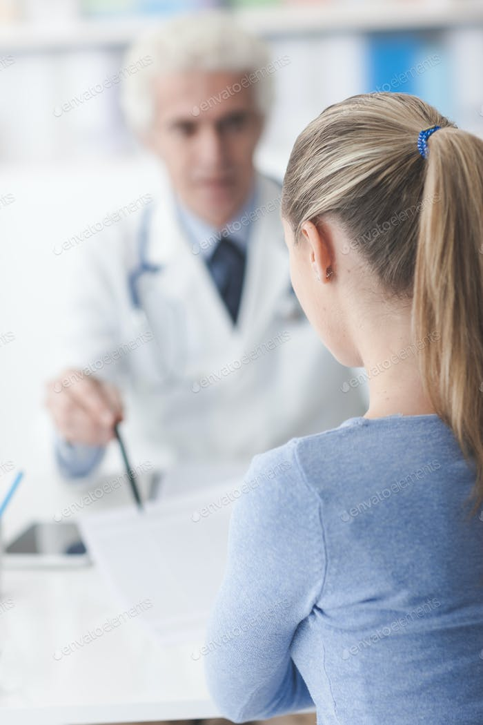 Doctor showing medical records to the patient