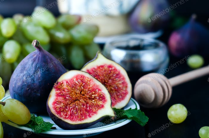 Grape and figs with on wooden table background.