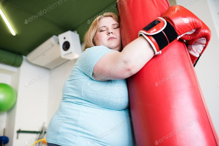 Exhausted Obese Woman in Workout