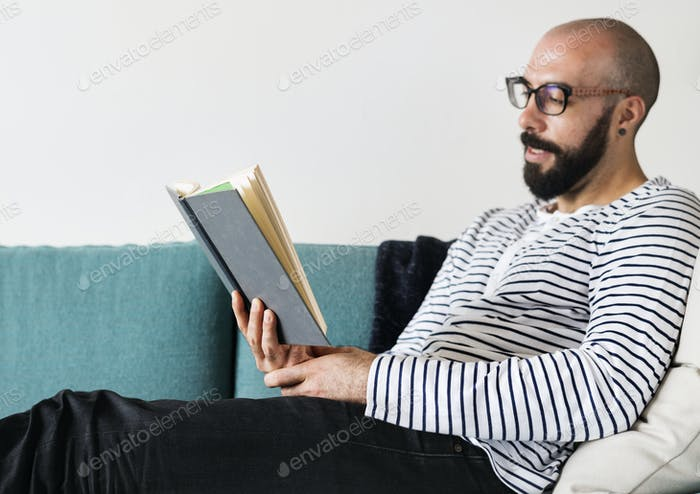 Closeup of man reading a book