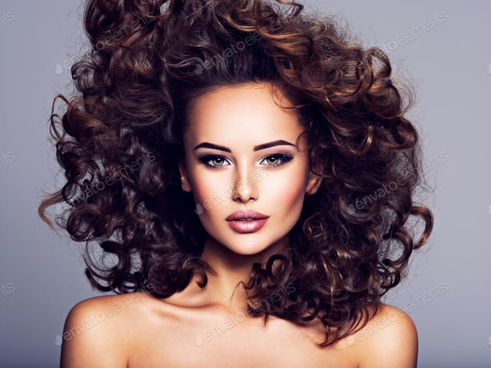 Woman with long bown curly hair