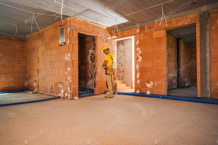 Caucasian Construction Worker Finishing Building Interior