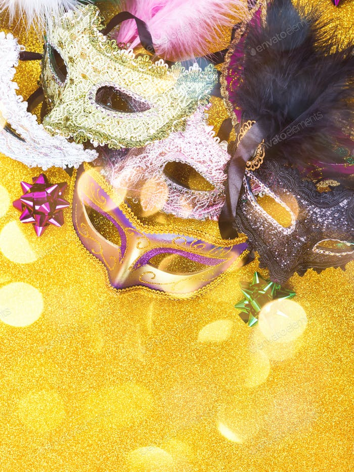 Carnival mardi gras party masks on gold background