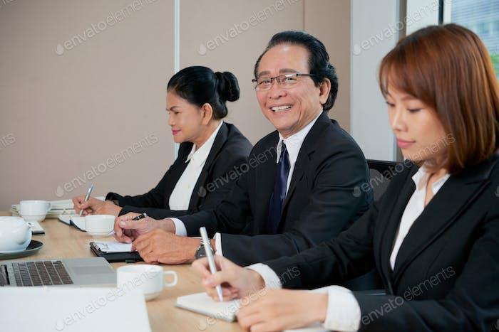 Businessman attending meeting