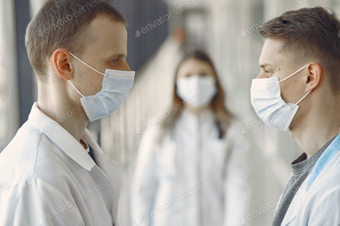 Medical students are in the hallway in masks