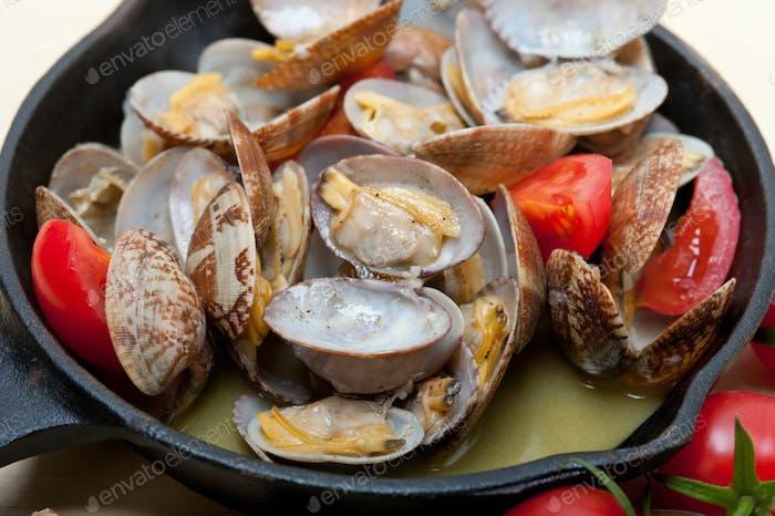 fresh clams on an iron skillet