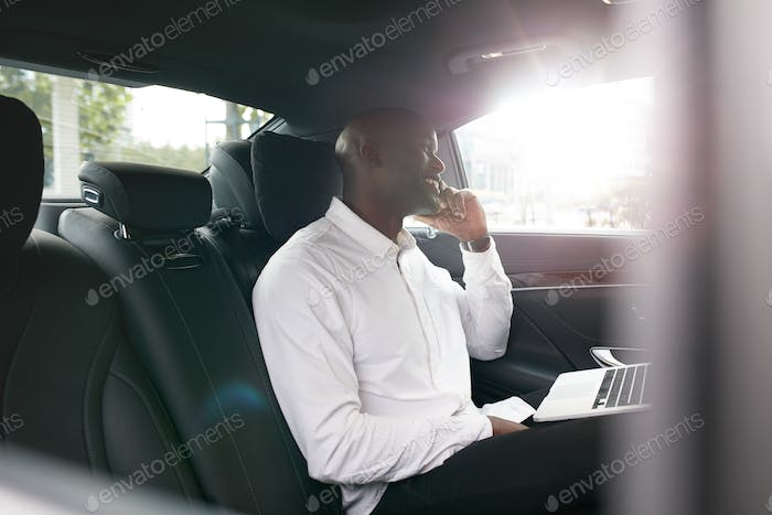 Young entrepreneur working during travelling to office