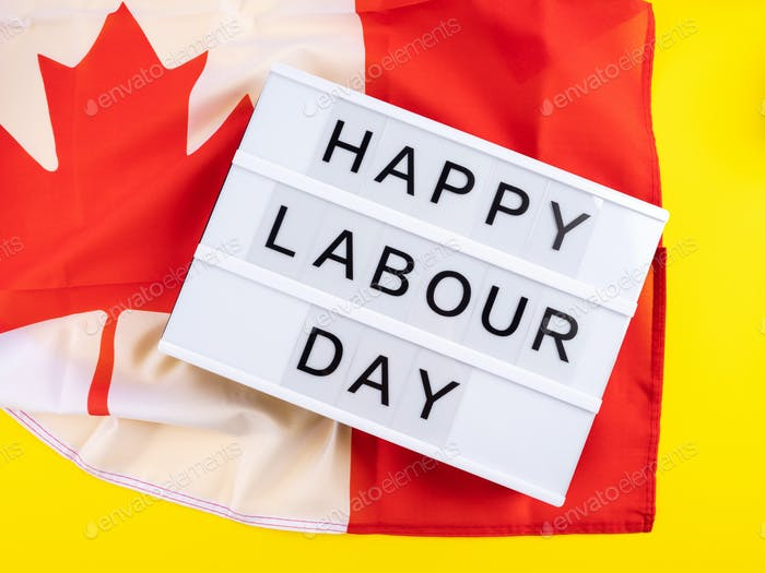 Happy Labour Day greetings on lightbox with canadian flag