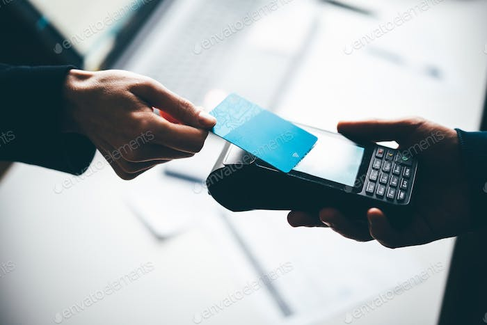 Customer Making Purchase Using Contactless Payment.