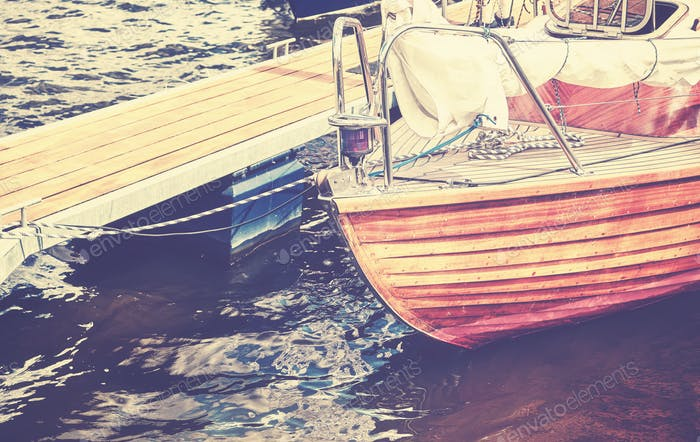 Vintage toned close up picture of an old wooden sailing boat
