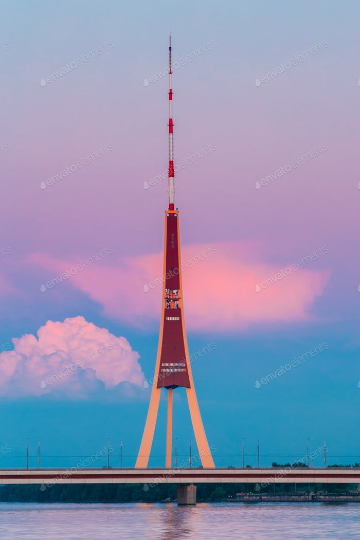 Riga, Latvia. Famous Landmark Television Tower In Pink Purple Su