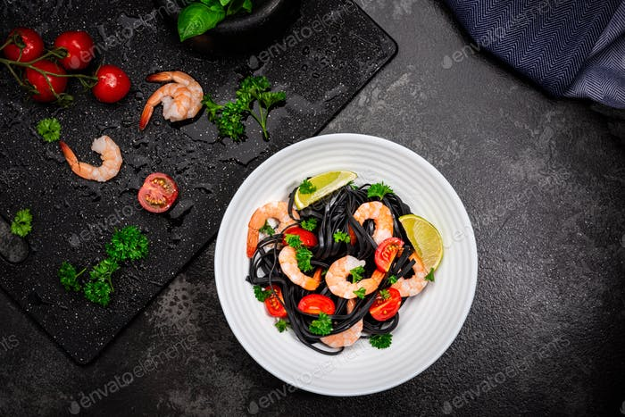 Squid Ink Pasta With Seafood, Herbs, Cherry Tomatoes.