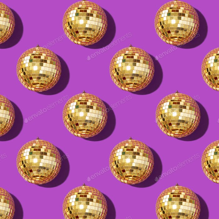 New year baubles. Shiny gold disco balls on violet background. Pop disco style attributes, retro