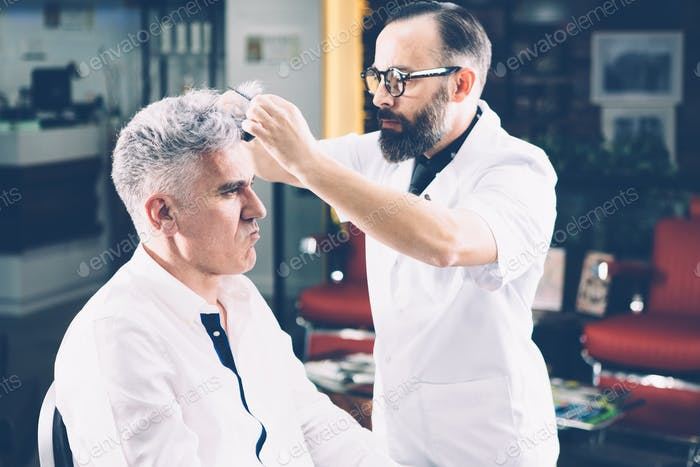 Barber hairdressing a customer