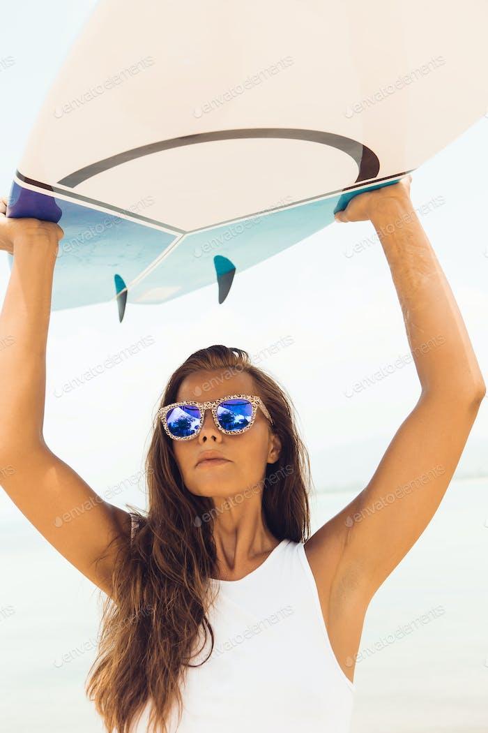 Sexy surfer girl on the sea ocean beach.